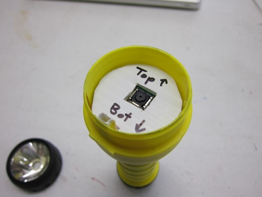 Plastic disk used to center the camera and secure electronics